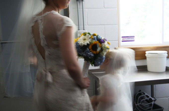bride and flower girl / photo by Mark Rawlings